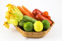 Fresh and ripe vegetables arranged in a basket stock image