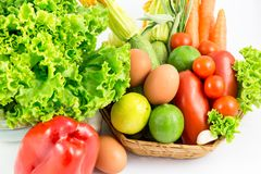 Fresh and ripe vegetables arranged in a basket isolated stock photos