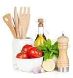 Fresh ripe vegetables, condiments and kitchen utensils Stock Photography