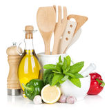 Fresh ripe vegetables, condiments and kitchen utensils Stock Photo