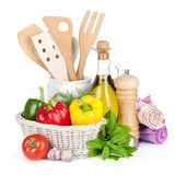 Fresh ripe vegetables, herbs and kitchen utensils Royalty Free Stock Photography