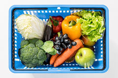 Fresh ripe vegetables in shopping basket on white Stock Images