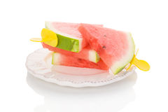 Fresh ripe water melon. Fresh ripe water melon as ice pop on plate on white background Royalty Free Stock Photo