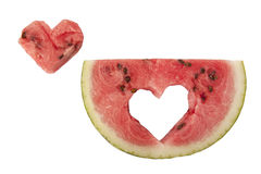 Fresh and ripe watermelon piece. With a heart cut out on a white Stock Photo