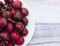Fresh ripe wet black cherries Stock Images