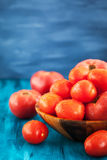 Fresh ripe wet red tomatoes in bowl. Fresh ripe wet red tomatoes in wooden bowl Royalty Free Stock Photos