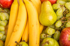 Fresh Ripe Whole Fruit. A mixture of fresh, whole fruit on a wood table Stock Photography