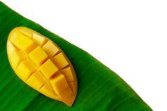 The fresh ripe yellow Barracuda or `Nam Dok May` mango on banana leaf. stock photos