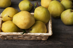 Fresh ripe yellow pears in a wicker basket Royalty Free Stock Photos