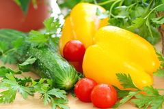 Fresh ripe yellow pepper and vegetables Stock Images