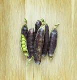 Fresh ripen peas  on wooden background Royalty Free Stock Photos