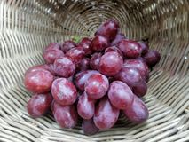 Fresh Ripen sweet grapes in bamboo basket Royalty Free Stock Photo