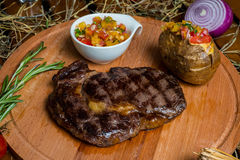 Fresh roast beef meat ribeye steak on wooden plate Stock Image