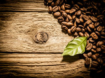 Fresh roast coffee beans on weathered driftwood Royalty Free Stock Image