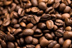 Fresh roasted arabica coffee beans background. Beautiful arabica coffee beans has very strong smell and excellent taste!Every coffee bean is unique Stock Image