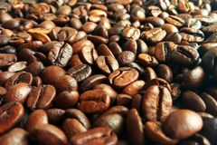 Fresh roasted brown coffee beans texture background stock image