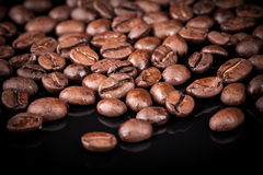 Fresh roasted coffee beans on black Royalty Free Stock Photo