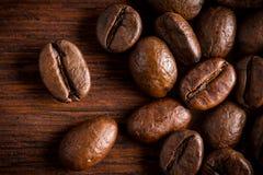 Fresh roasted coffee beans macro close oak wood background stock image