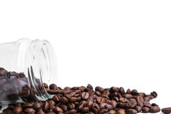 Fresh roasted coffee beans pour from glass jar Royalty Free Stock Image