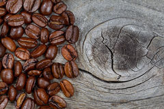 Fresh Roasted Coffee Beans on Rustic Wood Stock Photography