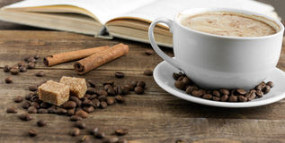 Fresh roasted coffee and book. Fresh roasted coffee and beans for breackfast stock photo