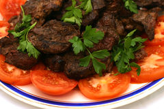 Fresh roasted meat with tomatos. On dish Stock Images