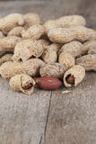 Fresh Roasted Peanuts on wooden table. Close up photo Stock Photo