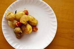 Fresh roasted potato with fried cherry Stock Photography