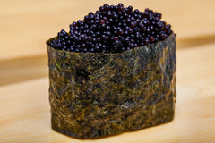 Fresh roll with black caviar Royalty Free Stock Image