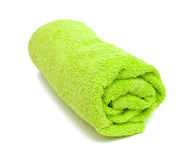 Fresh rolled green towel Royalty Free Stock Images