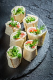 Fresh rolls with vegetables, cheese and herbs for a brunch. On black rock Stock Photography