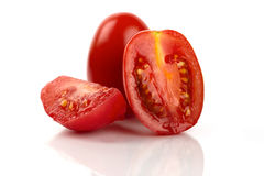 Fresh Roma tomatoes. Cut in front of white background Royalty Free Stock Photography