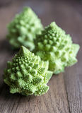 Fresh romanesco broccoli on the wooden board. Close up Stock Image