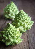 Fresh romanesco broccoli on the wooden board. Close up Royalty Free Stock Photos