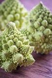 Fresh romanesco broccoli on the wooden board. Close up Stock Photo