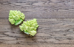 Fresh romanesco broccoli on the wooden board. Top view Stock Image