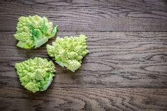 Fresh romanesco broccoli on the wooden board. Top view Stock Photo