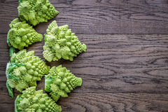 Fresh romanesco broccoli on the wooden board. Top view Royalty Free Stock Images