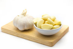 Fresh root garlic on wooden board Stock Photo