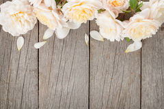 Fresh rose flowers on wooden background Royalty Free Stock Image
