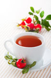 Fresh rose hip and drink Stock Image