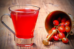 Fresh rose hip tea. And mortar with rose hips Stock Photo
