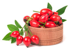 Fresh rosehip berries in a wooden bowl isolated on white background Stock Images