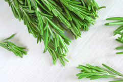 Fresh rosemary twigs on wooden background Stock Photos