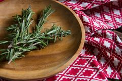 Fresh rosemary in wooden plate. Close-up of fresh rosemary in wooden plate Stock Photos
