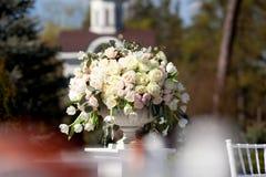 Fresh roses in ceramic vase outdoor Royalty Free Stock Photos