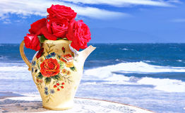 Fresh roses by the sea Stock Image