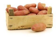 Fresh roseval potatoes ina wooden box Stock Photos