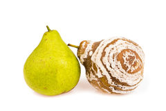 Fresh and rotten pears isolated Stock Photo