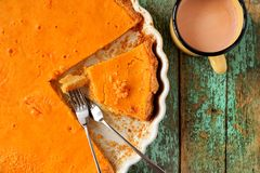 Fresh round bright orange homemade pumpkin pie in white baking d Stock Photos